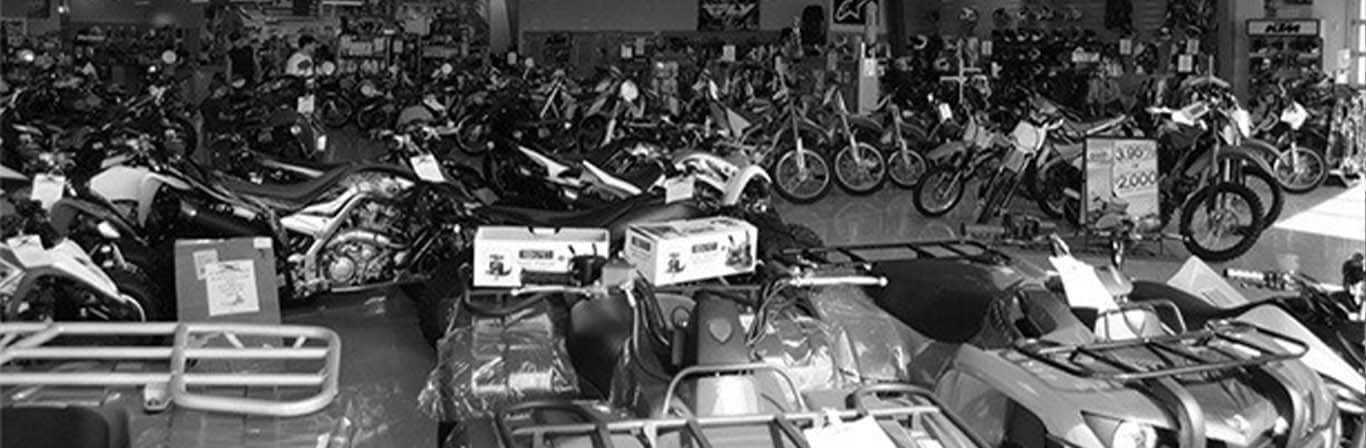 Black and white banner image of Experience Powersports' Showroom Floor